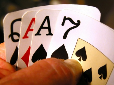 Most players play a lot of hands in Omaha, more hands than they play in Hold'em. Generally, the proper play is the reverse. However many hands you play in